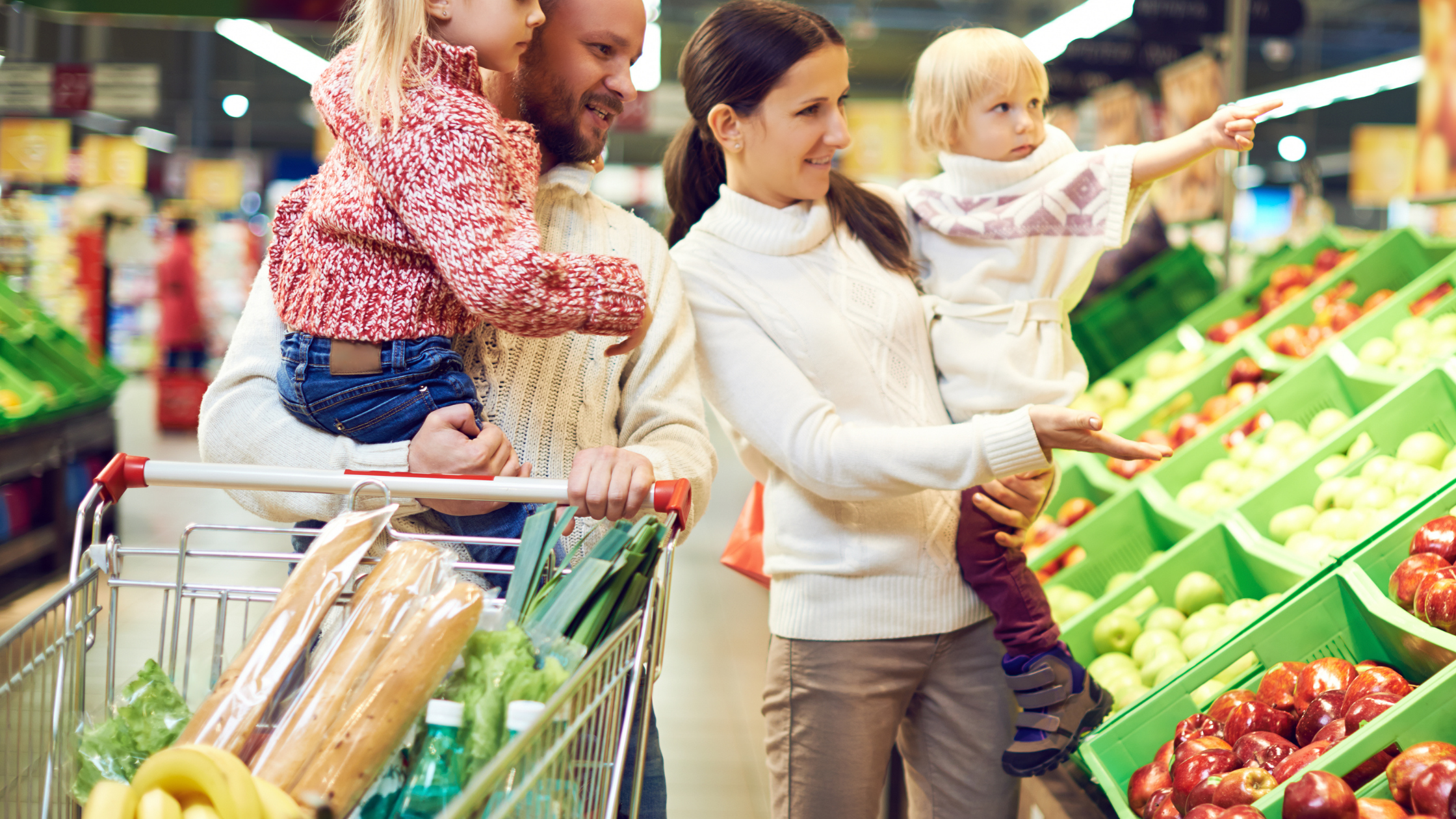 Family spending money at grocery store with Save